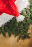 Santa& x27;s hat. On a wooden background Royalty Free Stock Photos