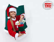Santa's helper bringing you money for the holidays Royalty Free Stock Photos