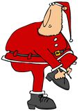 Santa's helper putting on his boots Royalty Free Stock Photos