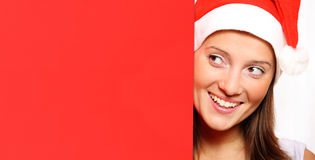 Santa's helper with red board Royalty Free Stock Images
