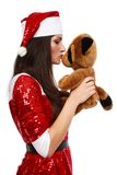 Santa's helper with teddy bear Stock Photography