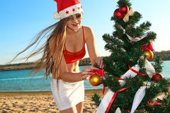 Santa's helper at the tropical beach Royalty Free Stock Images