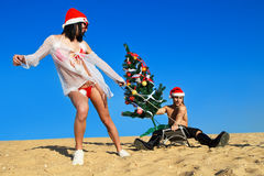 Santa's helper at the tropical beach Stock Images