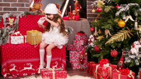 Santa`s helper wrapping gifts, sort the presents stock video footage