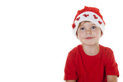 Santa's Helper. Young boy wearing a Santa hat looking away from the camera Royalty Free Stock Image