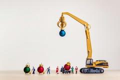 Santa`s helpers carries Christmas balls royalty free stock photos