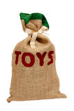 Santa's hessian sack full of toys and tied with satin ribbon Royalty Free Stock Photography