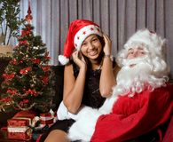 On santa's lap Royalty Free Stock Photography