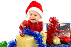 Santa's little helper baby. With christmas gifts with white background Royalty Free Stock Image