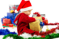Santa's little helper baby. With christmas gifts with white background Royalty Free Stock Photography