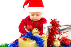 Santa's little helper baby. With christmas gifts with white background Royalty Free Stock Photos