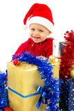 Santa's little helper baby. With christmas gifts with white background Stock Image