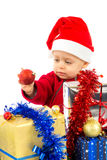 Santa's little helper baby. With christmas gifts with white background Royalty Free Stock Photo
