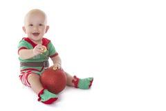 Santa's little helper. Little baby boy dressed in Elf costume, playing on the floor Stock Image