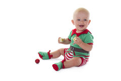 Santa's little helper. Little baby boy dressed in Elf costume, playing on the floor Stock Photography