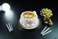 Santa's lovely cake Celebrate Christmas with bells and candles. Stock Photography