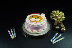 Santa's lovely cake Celebrate Christmas with bells and candles. Royalty Free Stock Photography