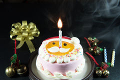 Santa's lovely cake Celebrate Christmas with bells and candles. Stock Photo