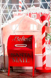 Santa's Mailbox. Letter box for santa's mails set to a background of candy canes and houses Royalty Free Stock Images
