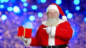Santa`s pointing at the christmas gift. stock video footage