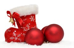 Santa's red boot with baubles in snow on white Stock Photos