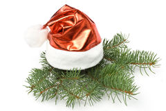 Santa's red hat and fir tree branch Royalty Free Stock Photography