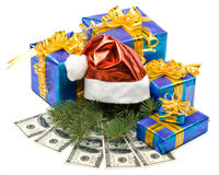 Santa's red hat, gift boxes and money Royalty Free Stock Photos