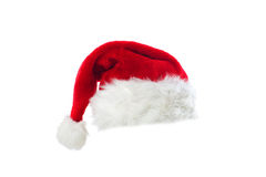 Santa's red hat isolated on white. Santa's red hat isolated over white background Royalty Free Stock Images