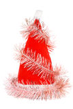 Santa's red hat with pink tinsel isolated stock photography