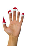 Santa's red hats on fingers Stock Image