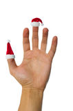 Santa's red hats on fingers Royalty Free Stock Photo