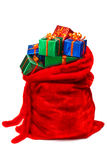Santa's sack filled with gifts. Bag of Santa Claus with gifts. Isolated on white Royalty Free Stock Photography