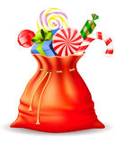 Santa's sack with gifts. And different candies Royalty Free Stock Image