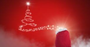 Santa`s sack and Snowflake Christmas tree pattern shape glowing. Digital composite of Santa`s sack and Snowflake Christmas tree pattern shape glowing Stock Photo