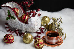Santa's Sleigh Setting for Christmas and Coffee. Home decor Santa and his sleigh on snow and tree decorations table setting accompanied by a warm cup of coffee royalty free stock photos
