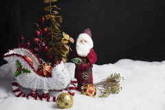 Santa's Sleigh Setting for Christmas. Home decor Santa and his sleigh on snow and tree decorations table setting Royalty Free Stock Photo