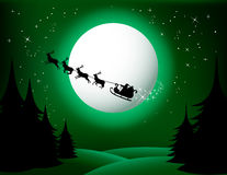 Santa sleigh and reindeer. Illustration of Santa sleigh and reindeer flying in front of full moon over green Christmas countryside Stock Image