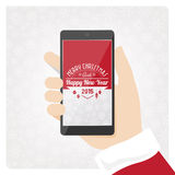 Santa's smartphone. Santa claus holding mobile smart phone with text and copyspace Stock Photo
