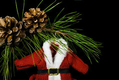 Santa's Sweater. Holiday sweater ornament hanging from pine bough Royalty Free Stock Photos