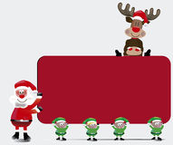 Santa's team  with Sign Card Stock Photography