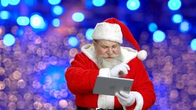 Santa`s telling a story. stock video footage
