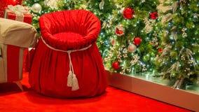 Santa`s Toy Sack And Christmas Trees stock photos