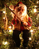 Santa's Trophy. Santa holding his catch ornament Stock Images
