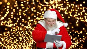 Santa`s using the tablet to talk. stock video