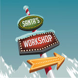 Santa's Workshop retro marquee sign with snowy glaciers vector illustration