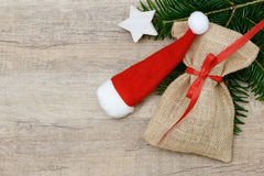 Santa sac and Christmas hat lying Stock Images