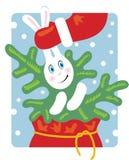 Santa saca de un conejo el bolso. Foto de archivo