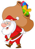 Santa with sack. Santa Claus carrying a big gifts sack Stock Photo