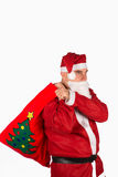 Santa with sack and presents Stock Images
