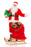 Santa with sack of toys and sledge isolated Royalty Free Stock Photography
